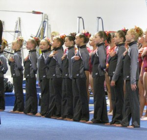 Listening to the national anthem before the competition begins. Photo courtesy of Erin Pelton.
