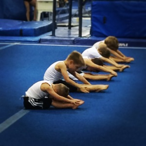 Two of my sons stretching in their boys' pre-team class.